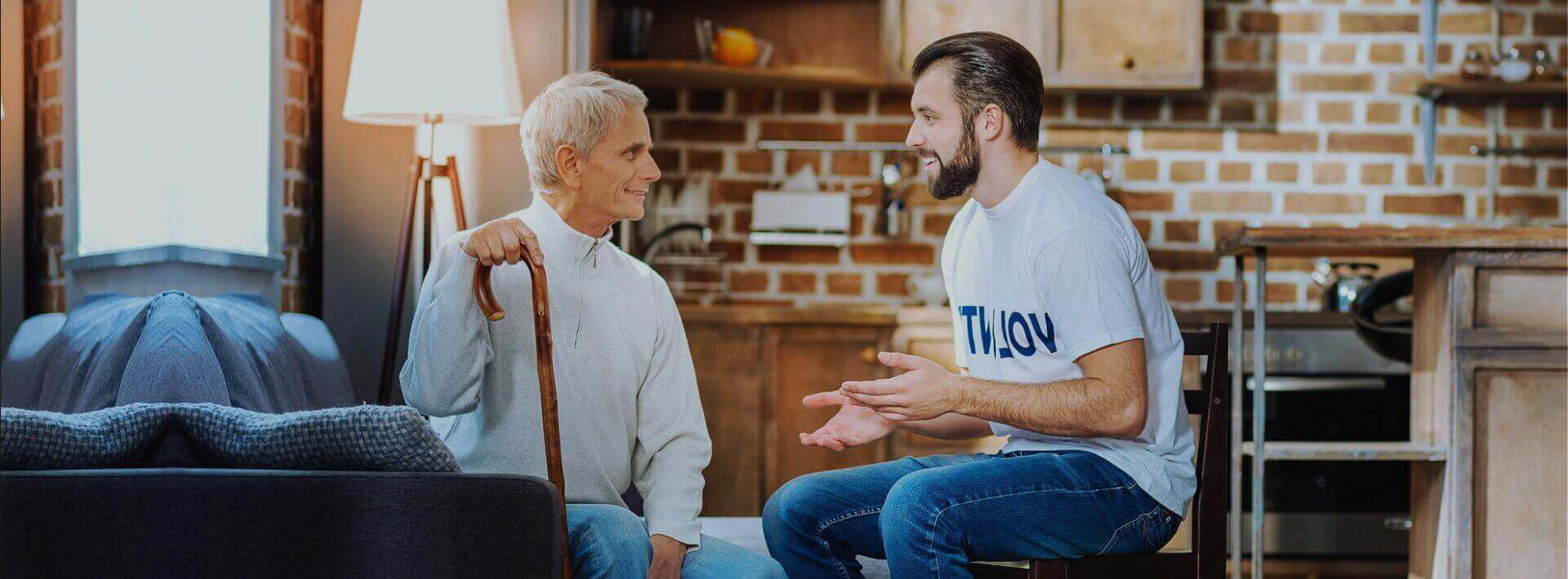senior man and a man talking