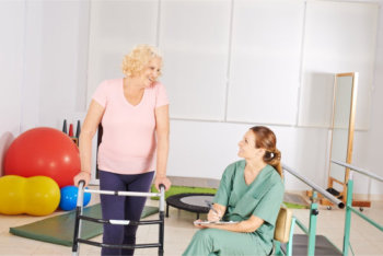 elderly woman and her physical therapist